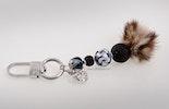 Schlüssel-/Taschenanhänger mit Glasperlen und Fellpuschel. Kundenbestellung aus Zürich.