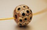 Glasperle aus Muranoglas beige/schwarz CHF 15.-
