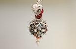 Halskette mit Anhänger mit Muranoglasperlen. Verkauft/Aargau
