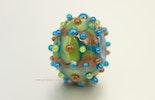 Glasperle/Bead in grün, blau und braun. vergeben / Basel