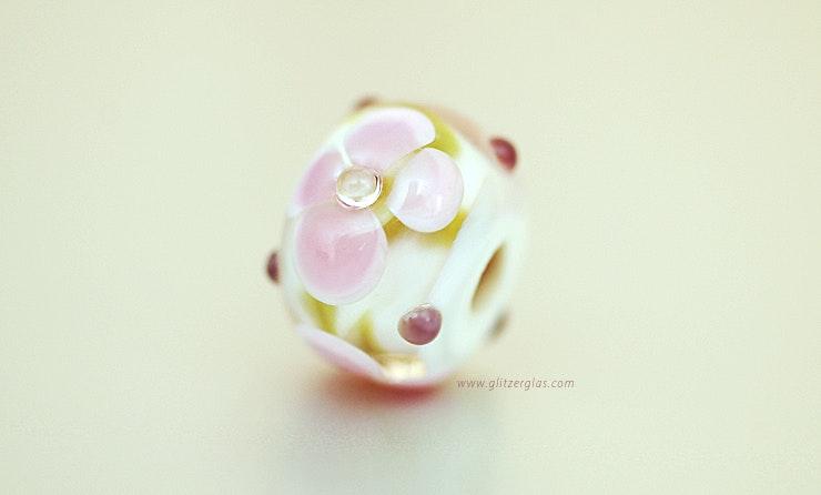 Perle aus Muranoglas mit grün und viollet