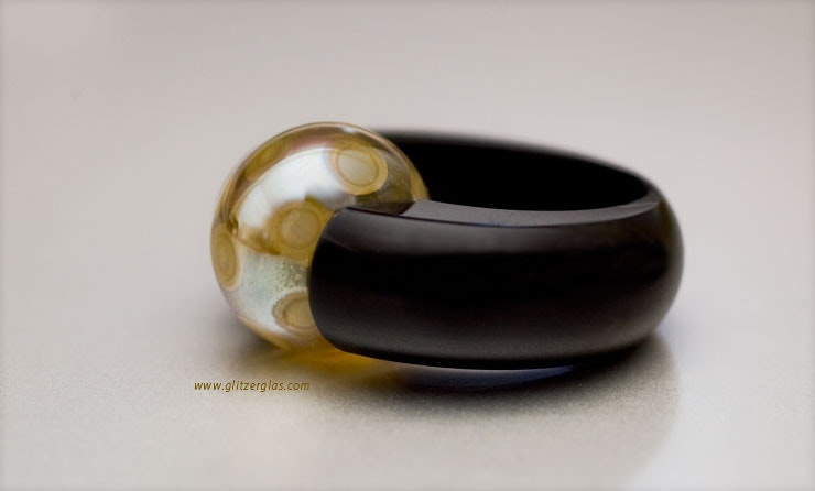 """""""Sunny Gold"""" with black acrylic ring CHF 40 - (size about 18)"""