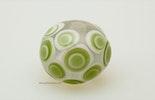 """light-green"" Glasperle in klar mit weiss/grünen Dots"