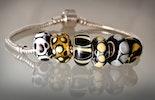 Troll-oder Pandorastyle Modulperlen in schwarz/beige/bernsteinfarben