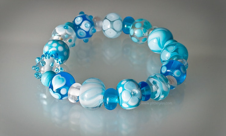 Armand with turquoise beads on elastic.