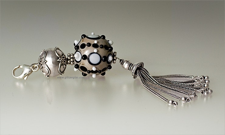 Pendant with large glass beads and real silver. With snap link to attach to a belt.