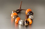 Changeable jewelry beads in orange and brown for Sabrina, Germany.