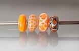 """Orange"" Modulglasperlen aus Muranoglas mit echt Silberhülse"