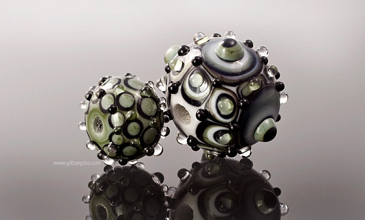 """Rumba"" 2er Set Glasperlen in grau/schwarz/oliv"