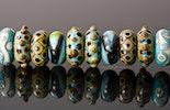 verschiedenen Modulperlen in türkis Farben