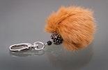 """""""Lion"""" Schlüssel- oder Tascehnanhänger mit brauner Glasperle und Fellpuschel"""