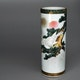 """Vase handpainted porcelain depicting an eagle in a winter landscape with mount Fuji in the background. Very elaborate rim enamel decoration. D9cm, H23.5cm, ca. 1960's, signed """"Kutani tsukuru"""" (made in the 9 valleys)."""