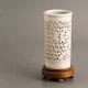 China brushpot in Dehua porcelain, ca. 1925, cherry blossom pierced decoration